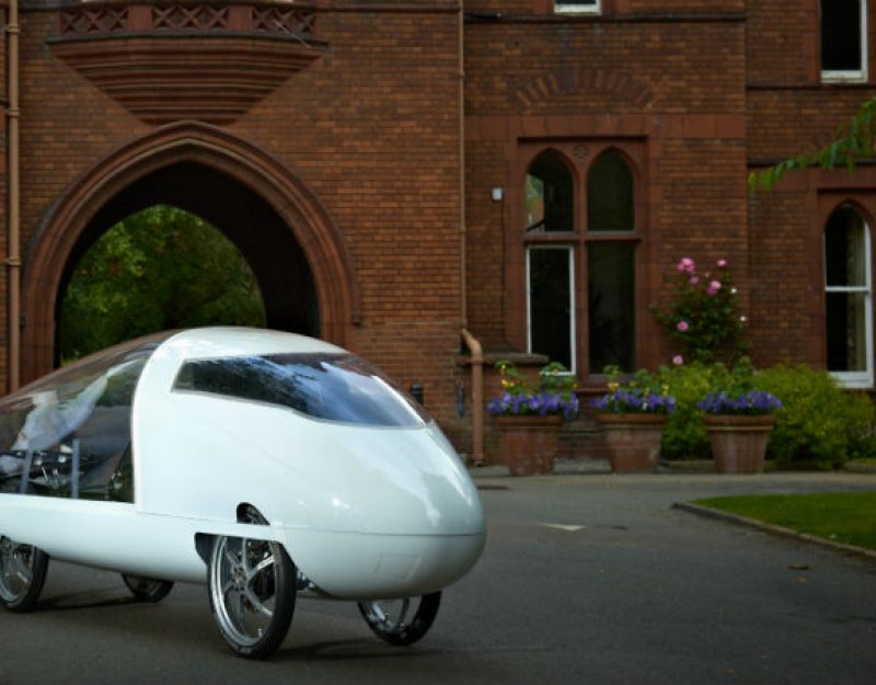 CUER's 2013 car, Resolution, in the grounds of Girton College