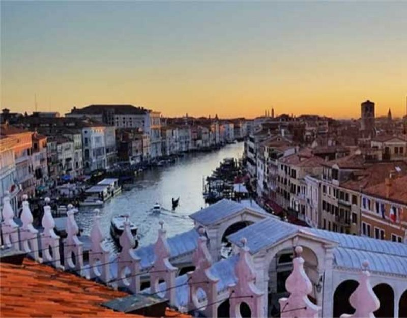 A view of Venice's Grand Canal from above at sunset