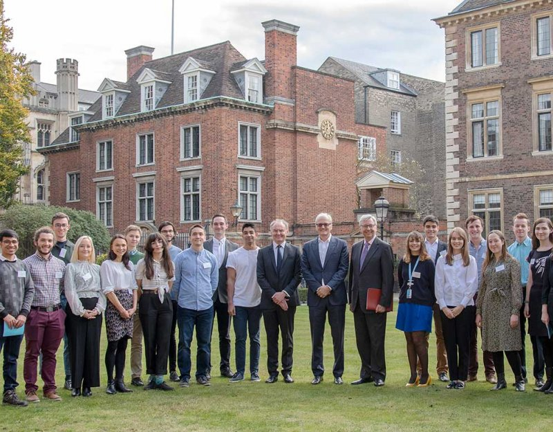 23 Harding Scholars standing in front of St Catherine's College with the VC Stephen Troope and philanthropist David Harding