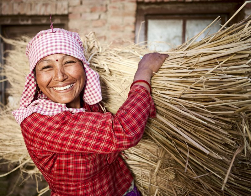 Nepali woman with crops