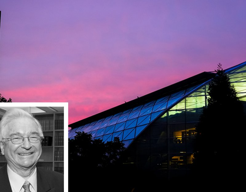 The late Professor Sir David Williams and the Faculty of Law building at dusk