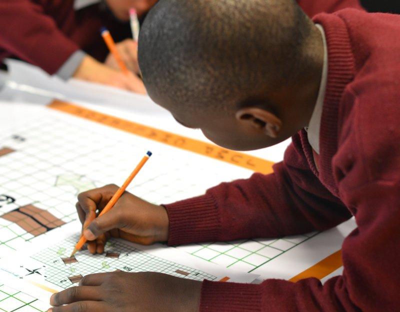A boy at a Millennium Mathematics Project event
