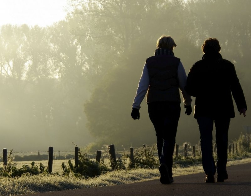 Two women walking in the countryside