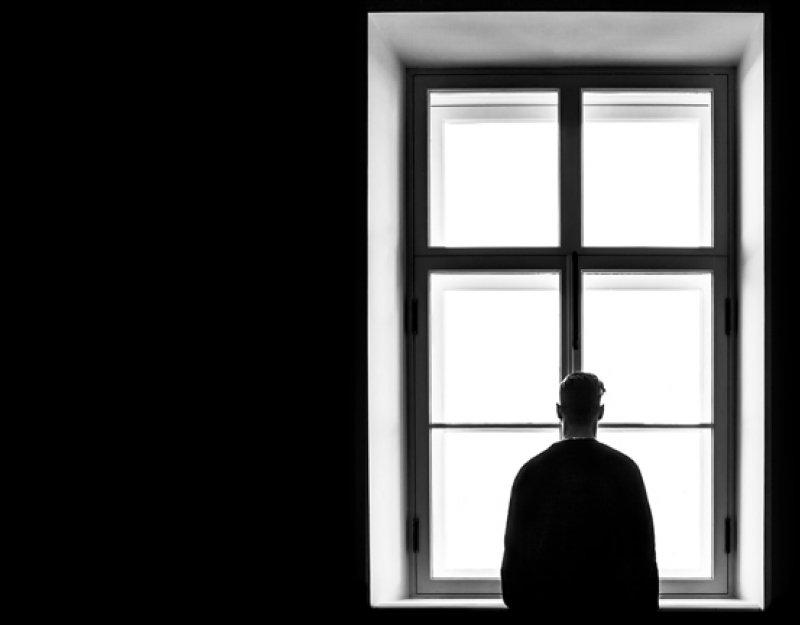 Man standing in front of window