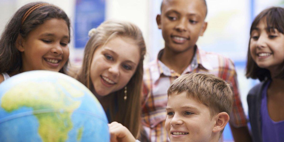 Children looking at globe