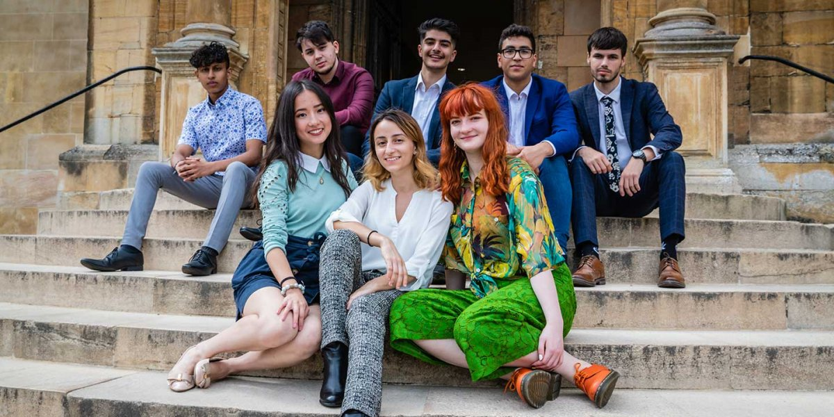 Group of undergraduate students sitting on steps