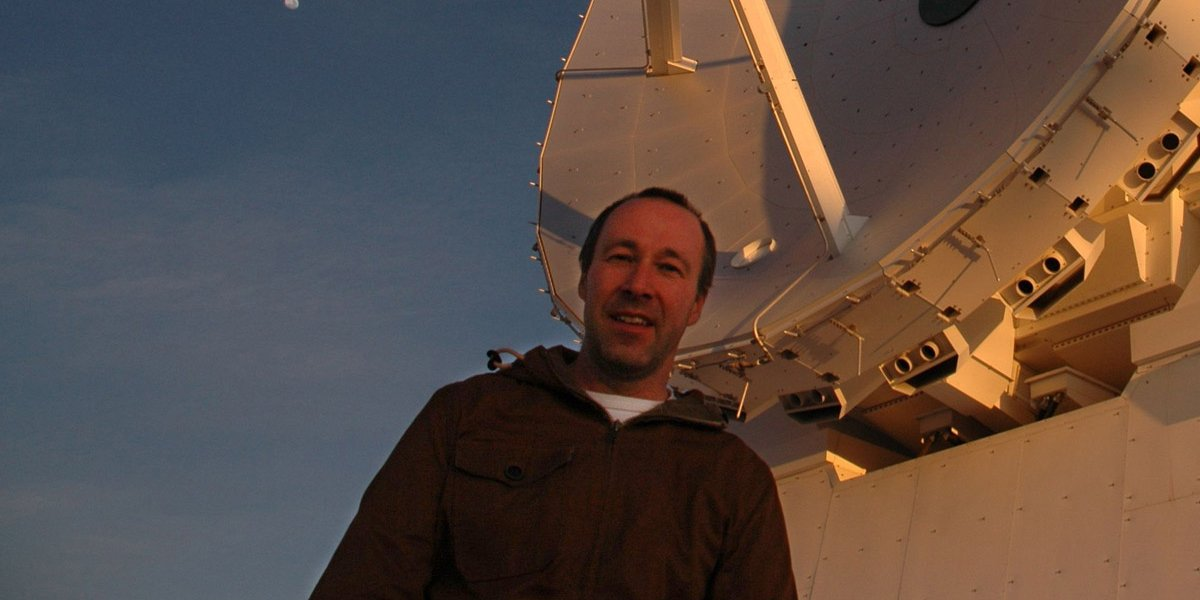 Dr John Richer in front of one of the Atacama Large Millimetre Array's antennas (credit: John Richer)