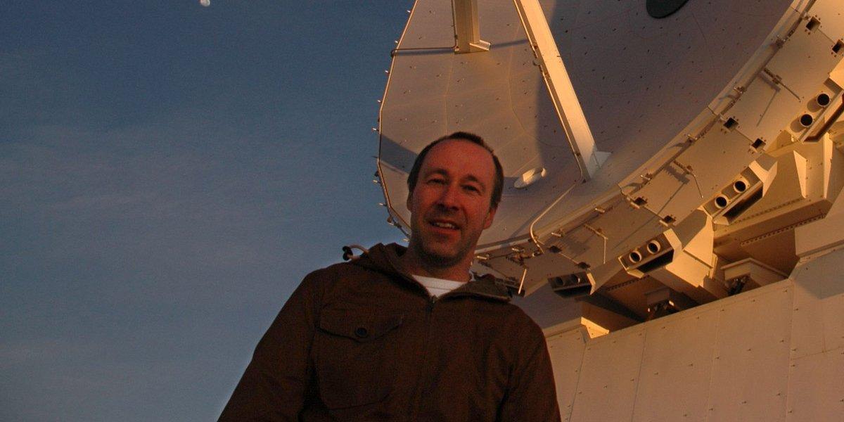Dr John Richer in front of one of the Atacama Large Millimetre Array's antennas (credit: John Richer)